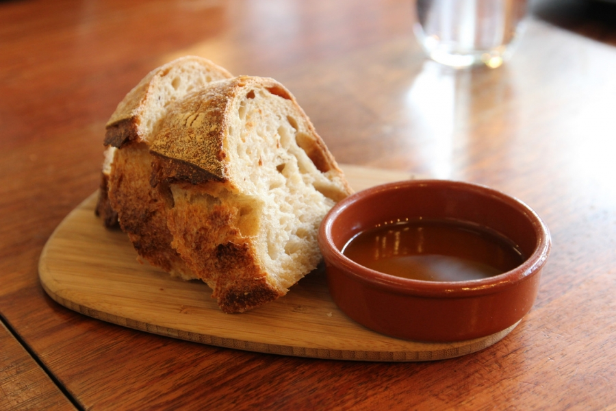 Complimentary Sourdough Bread w. Olive Oil and Salt Flakes