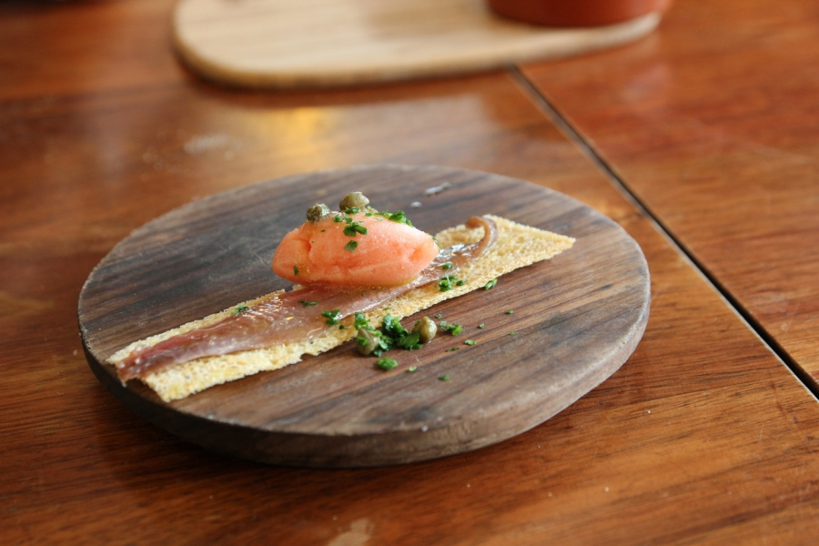 Anchoa: Cantabrian Artisan Anchovy on Crouton w. Smoked Tomato Sorbet $4