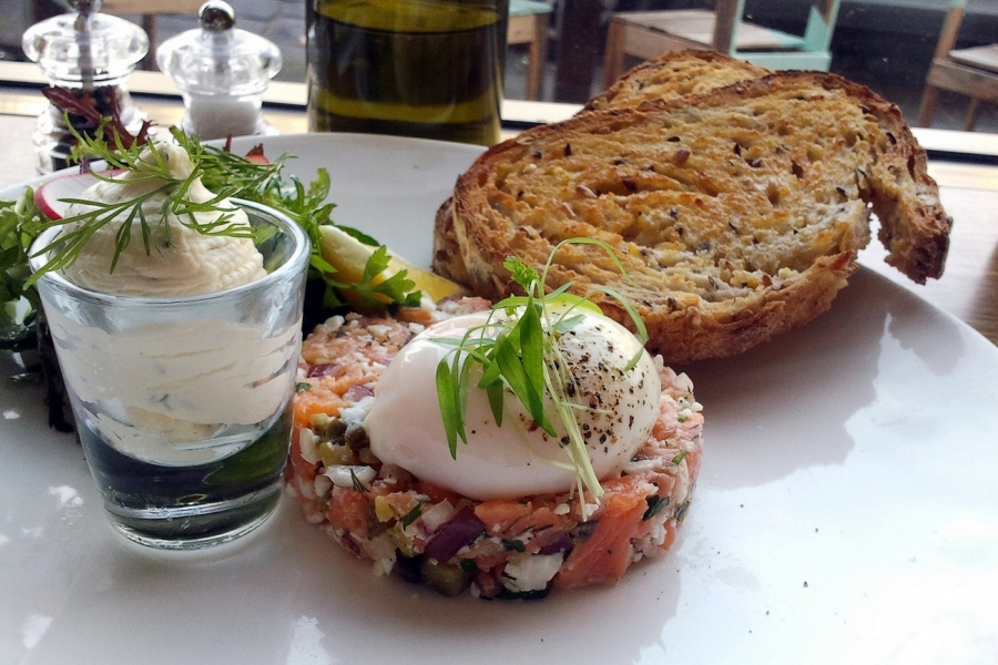 The Russian / Vodka & lemon house cured salmon tartare, free range poached egg, dill & lemon creme fraiche, seed & sprout sourdough