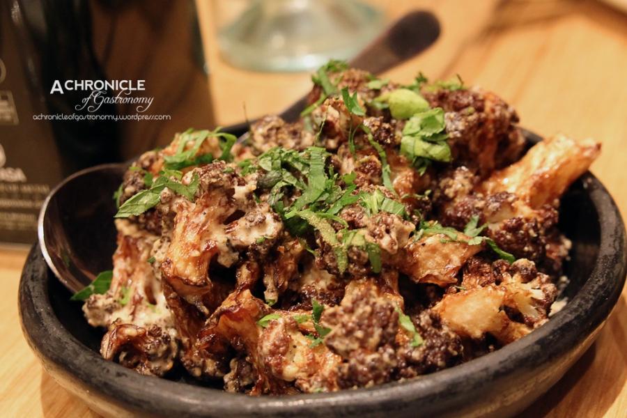 Cauliflower, pine nut sauce, ras el hanout, herbs ($8)
