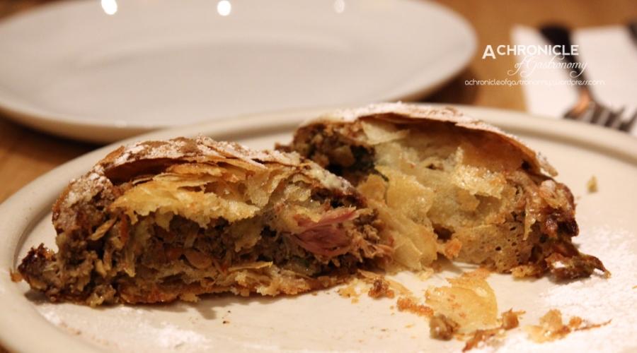 B'stilla - duck & chicken pie, almond, cinnamon, saffron ($14)
