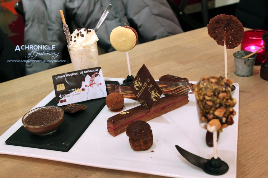 Chocolate Fondant, Log w. Raspberry and Crispy Biscuit Base, Chocolate Macaron, Crème Brulee, Caramelised Tuille, Icecream w. Choc and Nut Coat, Chantill