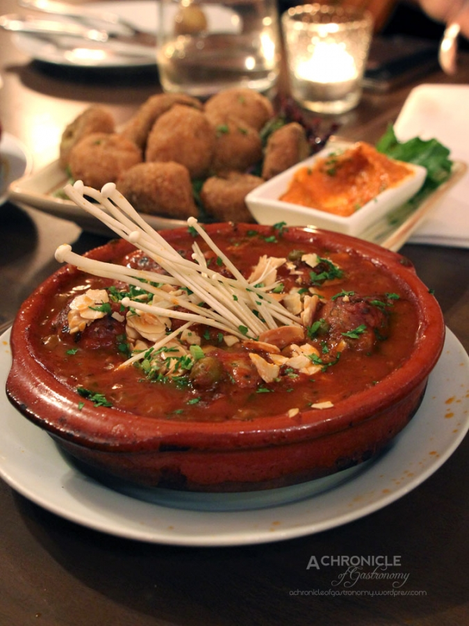 Albondigas Arcadia - beef & pork meatballs w. tomato sauce, green peas, almond ($12)