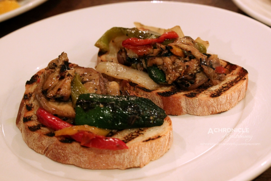 Escalivada - Catalan bread salad with grilled zucchini, eggplant, peppers, onion, tomato & herbs with an anchoiade dressing