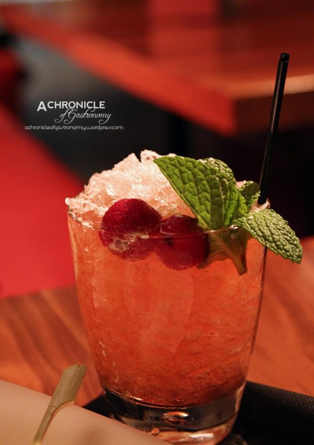 White Tsurai - TK40 Hokusetsu Sake, lychee, cranberry, a splash of chilli and Pimms ($22)