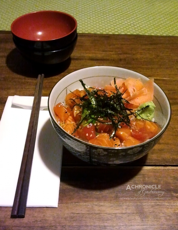 Sashimidon - Salmon & Tuna Sashimi Marinated in Soy and Garlic, Served on Sushi Rice w Nori, Shiso, Wasabi ($18)