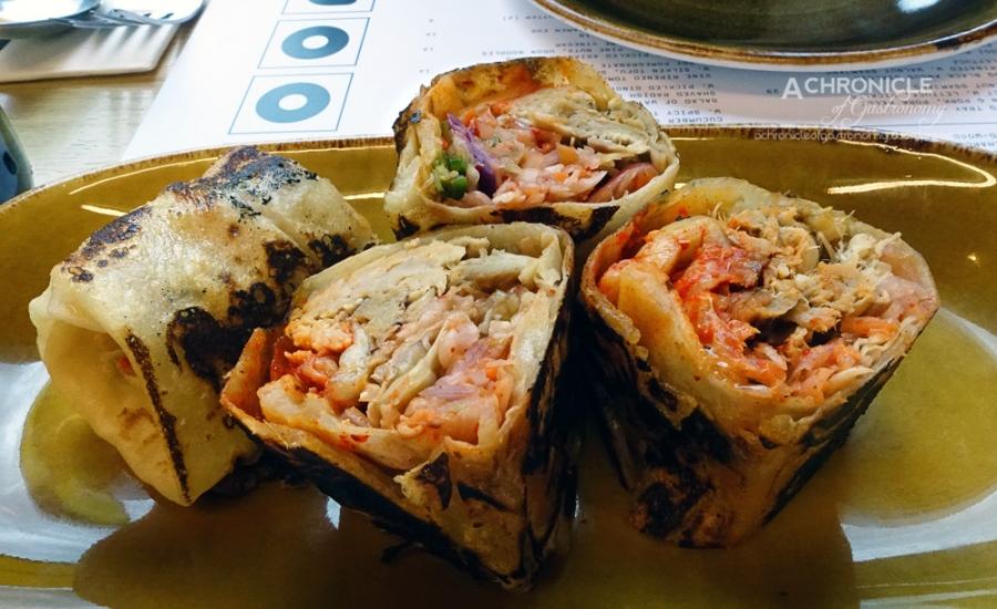 Ssam Roti Roll w. Pulled Pork, Slaw, Kimchi, Burnt Chilli Mayo ($12)