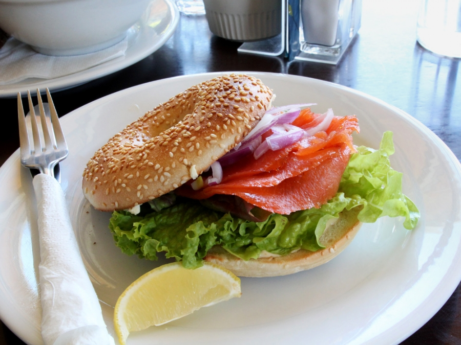 Local-Farmed Aoraki Smoked Salmon Bagel With Aioli, Cream Cheese, Lettuce, Red Onion And A Wedge Of Lemon ($15)