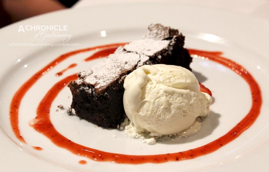 Flourless Chocolate Cake, Berry Coulis, Vanilla Bean Ice Cream