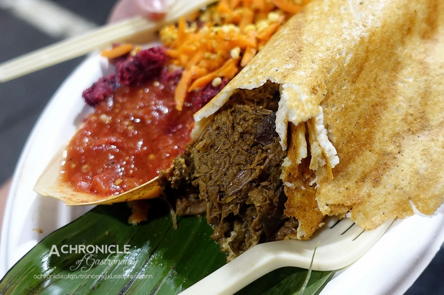 Babaji's Kitchen (31) Slow Cooked Beef Kallu Shappu Dosa, Beetroot Thoran, Kosambri, Tomato Chutney ($12)