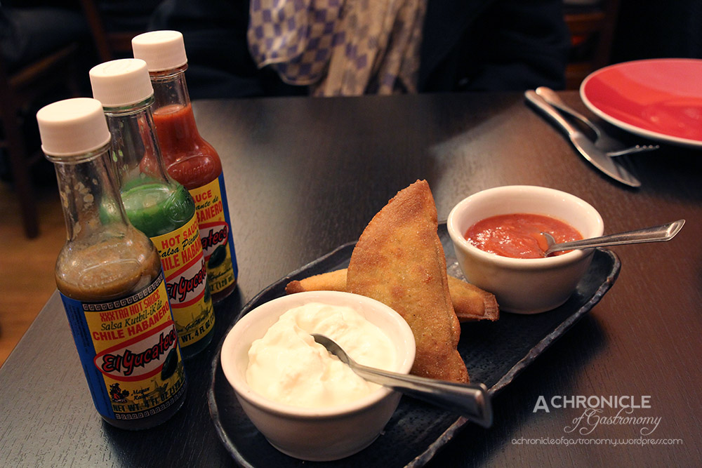 Slow-Cooked Beef and Panela Cheese Empanadas w. Sour Cream And Salsa Brava (4 For $16)