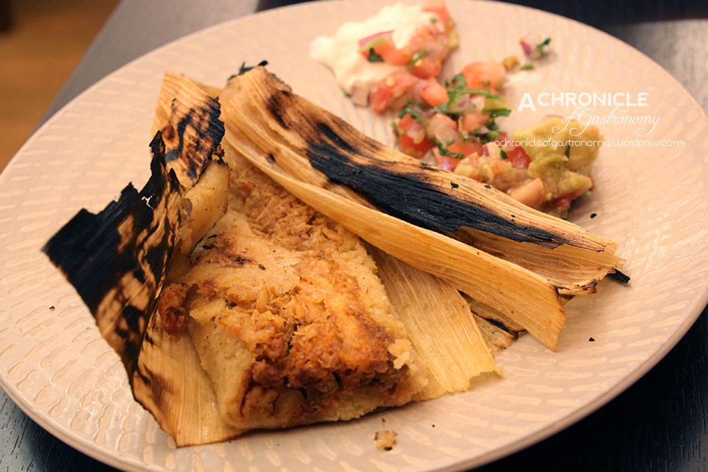 Tamales De Pollo (3 For $18) – Steamed Parcels Of Corn Flour Stuffed w. Chicken, Ancho Chillies Wrapped In Corn Husk, Served w. Sour Cream, Pico De Gallo And Guacamole