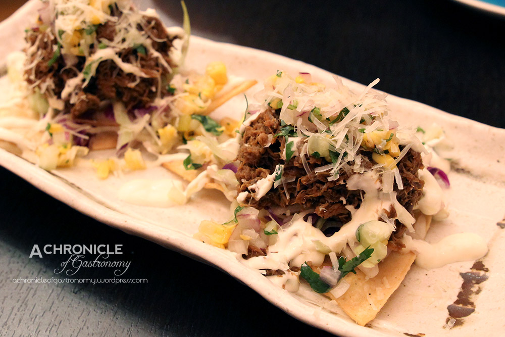 Slow-cooked Beef, Corn Salsa, Cucumber and Sour Cream Tostaditas (4 For $12)