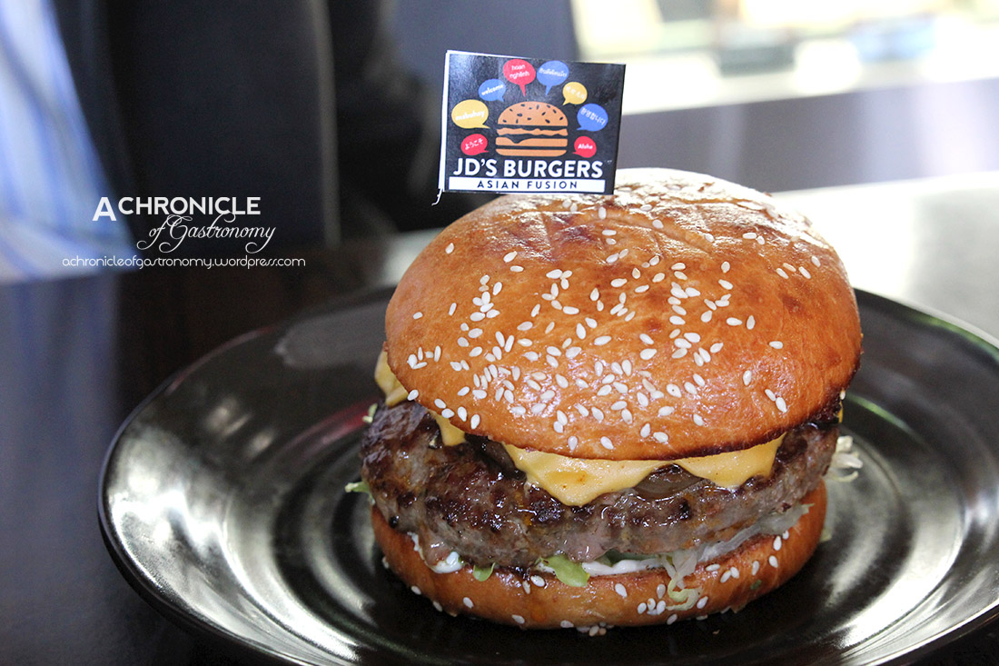 Ultimate Black Pepper Beef - French Brioche Bun, Black Pepper Sauce, Special Mayonnaise, American Cheese, Grilled Bacon, Mushroom, Caramelised Onion, Lettuce, Tom ($12.50)