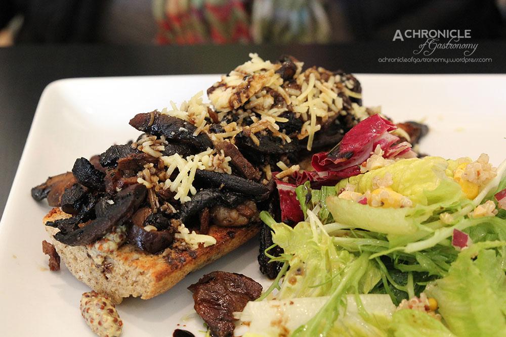 Free Range Rump Steak Tartine - Open Faced Steak Sandwich on Half Baguette, w Portobello Mushroom, Dijon, Aged Cheddar & served w Garden Salad ($18)