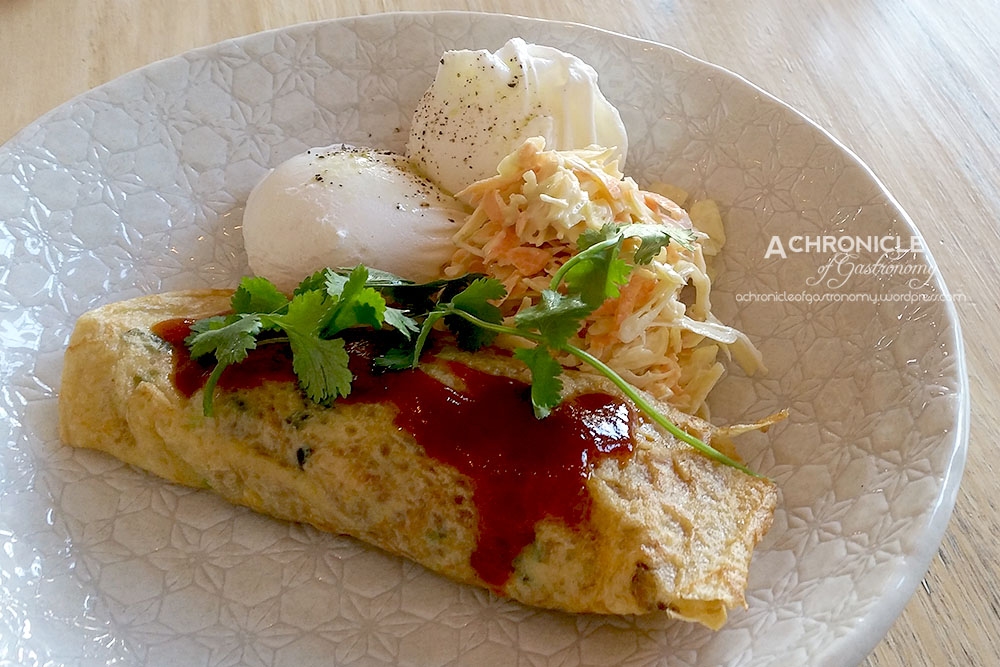 Pork Belly Crepe - Pulled Pork Belly in a Corn Crepe w. Poached Eggs, Fresh Slaw and House-made BBQ Sauce ($17)