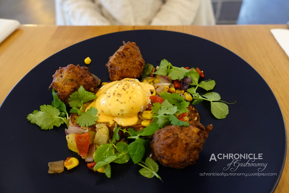 Sir Charles - Corn Fritters w. Poached Egg, Charred Salsa and Spicy Hollandaise ($16)
