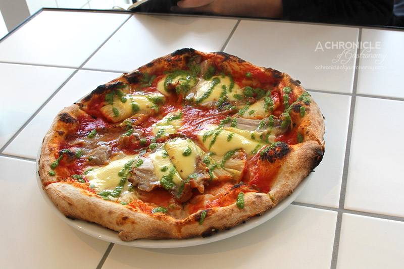 Homeslice - Tropical Pizza with Roasted Pork Shoulder, Pineapple, Salsa Verde, Mozzarella and Tomato ($18)