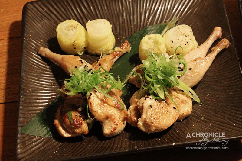 Kumo Izakaya and Sake Bar - Grilled Yuzu Marinated Quail with Wombok Leaf Roll