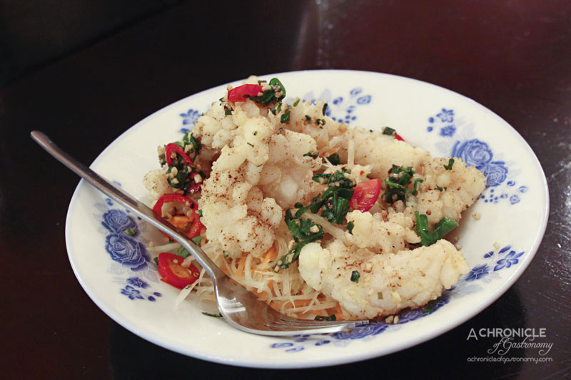 Masak Ku - Chilli and Szechuan Pepper Squid - Lightly Dusted and Spiced with Szechuan Pepper, Drizzled with Chilli Oil ($9.50)
