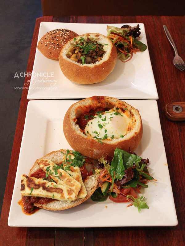 Dip In Cafe - Shakshuka - Slow Cooked Tomato Sauce, Two Baked Eggs, add Halloumi Cheese ($13,90+4,50) Make Hummus Not War - Homemade Hummus, Pan-fried Beef and Lamb, Pine Nuts, Mushrooms ($15.90)