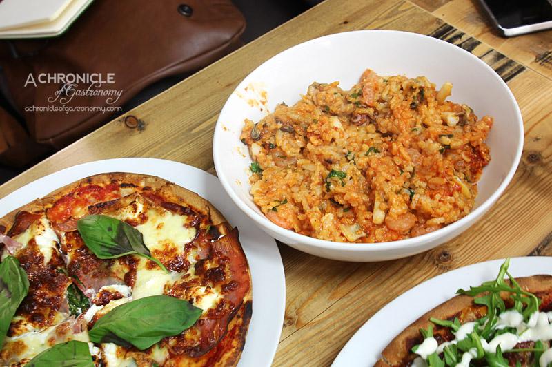 Old Mates Pizza and Pasta - Marinara Risotto - Mixed Seafood, White Wine, Garlic, Tomato And Basil Sauce ($11.90); Prosciutto Special – Tomato, Cheese, Spinach, Prosciutto, Bocconcini, Goats Cheese, Basil (Small, $10)