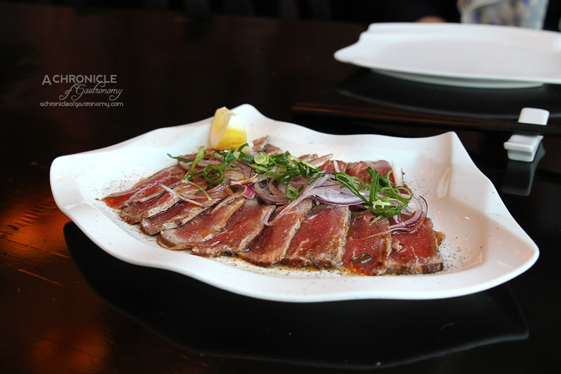 Miyako - Tataki Beef - Lightly Seared Beef Thinly Sliced, served with Black Pepper and Shiso Dressing ($16)