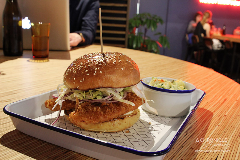 Rustica Canteen - Brioche Burger w Panko Crumbed Flounder, Red Onion, Iceberg Lettuce, Lime Aioli and Potato and Pickled Cucumber Salad ($14)