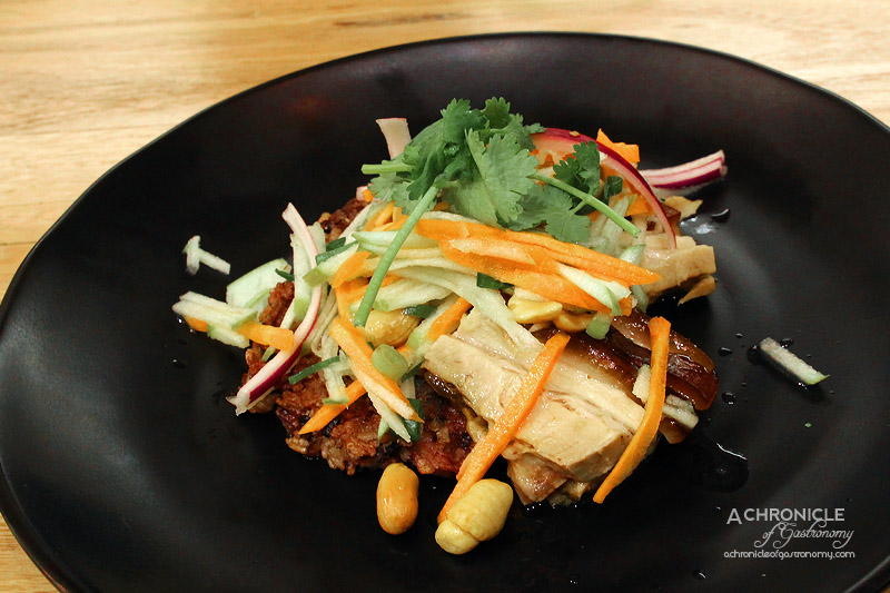 12's Cafe - Mini slow cooked pork belly in master stock served on rice cake with Thai green apple salad