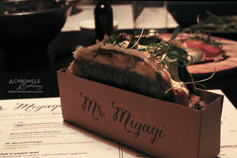 Mr Miyagi - Nori Taco - Grilled Salmon Belly, Sushi Rice, Spicy Napa Cabbage, Japanese Mayo, Chilli Oil ($12)