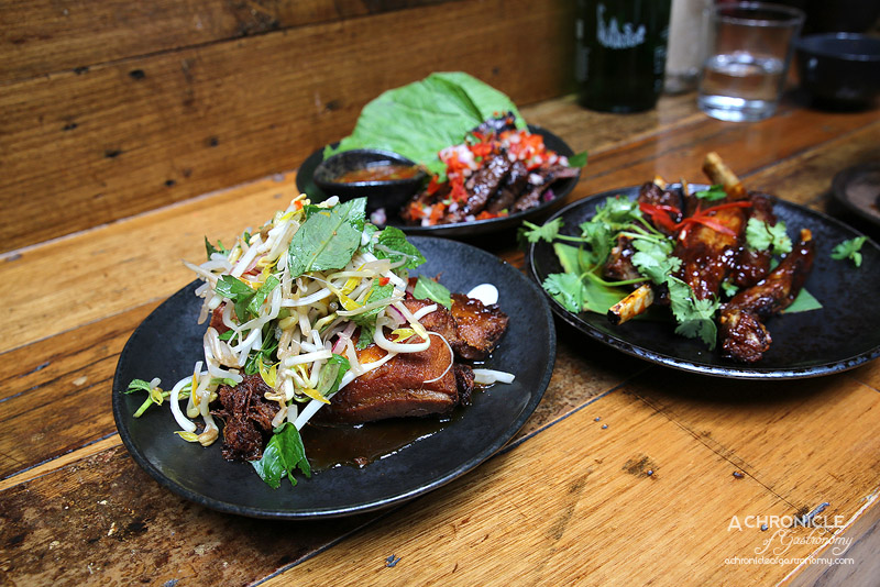 Rice Paper Scissors - Sticky Pork Belly - Muu Krob - Twice Cooked Pork in a Tamarind Caramel Sauce Topped with a Fragrant Herb Salad ($12)