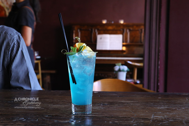The Piano Restaurant & Bar - Phuket Paradise - Gin, Thai Dark Rum, Blue Curacao, Fresh lime, Soda ($17.50)