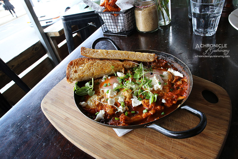 Babble - Baked Eggs - Free-range eggs pan-baked with pulled pork, traditional napoli sauce and roasted cauliflower, sprinkled with Danish feta and herbs ($18)