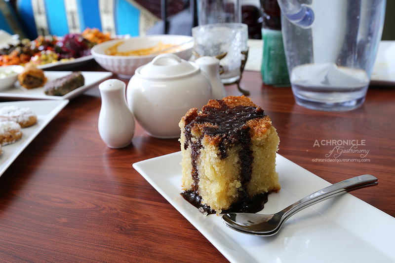 Hilulim - Semolina Cake with Chocolate Syrup ($4)