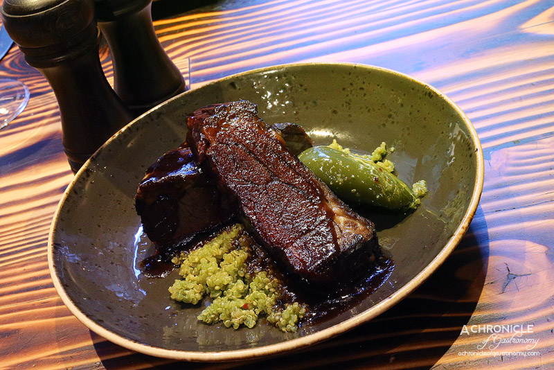 Pastuso - Lomo de Costilla - Beef Ribs Smoked and Slow Cooked in Aji Mirasol Master Stock, werved with Green Quinoa and Padron Pepper