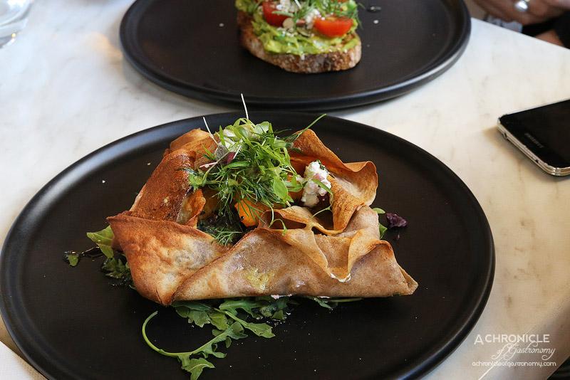 Cafe de la Ville - Galette of twice-baked pumpkin, braised cabbage, goat's curd, fresh herbs, citrus vinaigrette