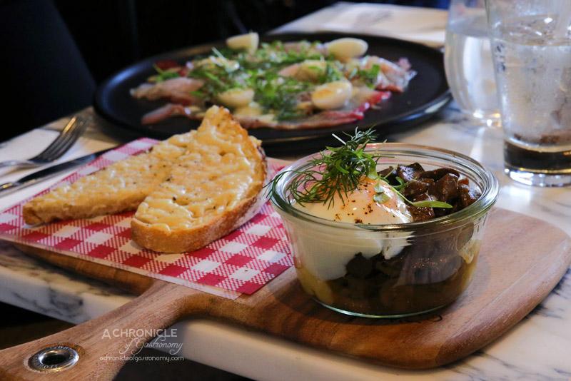 Cafe de la Ville - Creamy polenta, truffled mushroom ragout, sous vide egg, parmesan soldiers