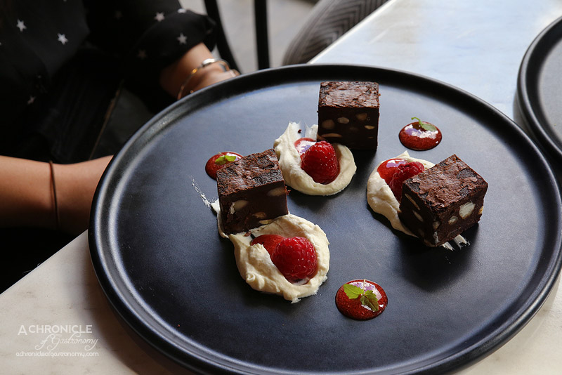 Cafe de la Ville - Chocolate and macadamia brownies with cream Cantilly and fresh raspberries