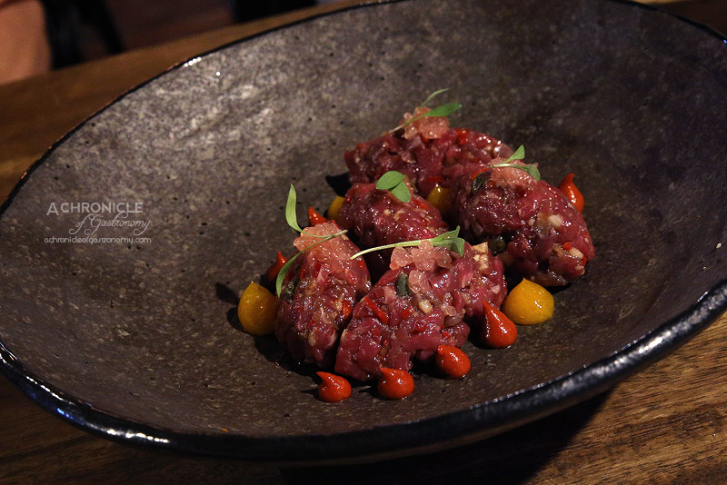 Pablo Honey - Grass Fed Beef Tartare - Salted Egg Yolk, Smoked Chilli, Finger Lime, Coriander & Cumin Seed Lavosh ($17)