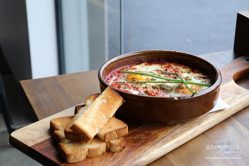 Rock Paper Scissors - Shakshouka Baked Eggs - Capsicum and tomato ragu, eggs, feta, spices, toasted gluten free bread fingers ($15.50)