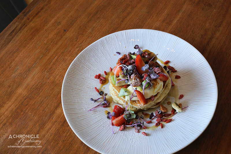 Rock Paper Scissors - Buttermilk Pancakes with grilled banana, strawberries, shaved honeycomb, kiwi fruit, double cream, maple syrup ($17.50)