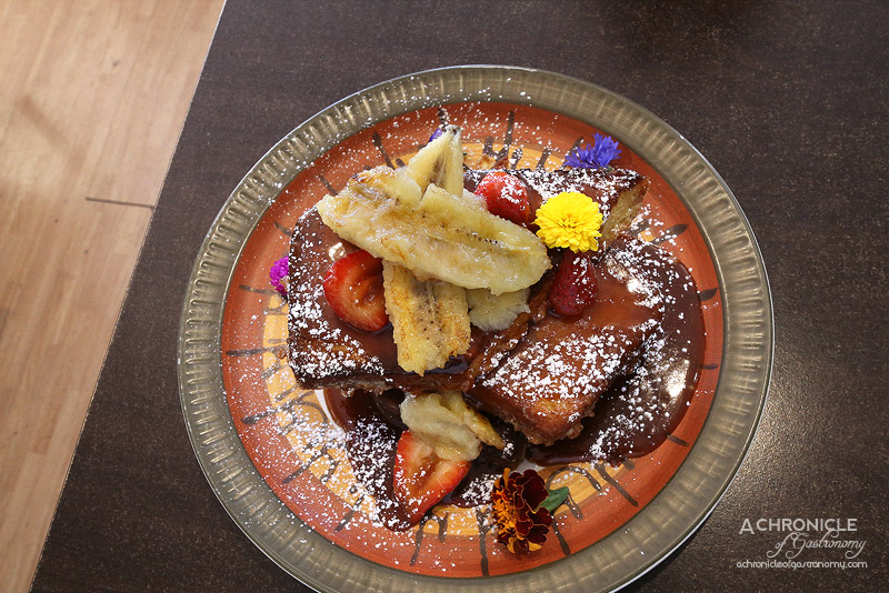 The Left Handed Chef - Banoffee French Toast - Brioche French toast topped with toffee sauce, fresh bananas and sweet strawberries ($16)