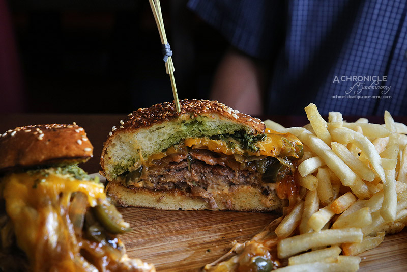 Three Crowns Hotel - The Flaming Crown - Quarter pound Cayenne spiced Angus beef pattie, melted American cheddar, bacon, fried onions, Jalapenos, Frank's red hot mayo, brioche, french fries ($18)