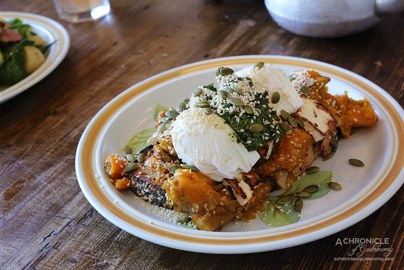Truman Cafe - Haloumi Brekkie - Pumpkin, leek and sesame seed smash on sourdough multigrain, poached eggs, grilled haloumi, kale and walnut pesto, toasted seeds ($16.50)