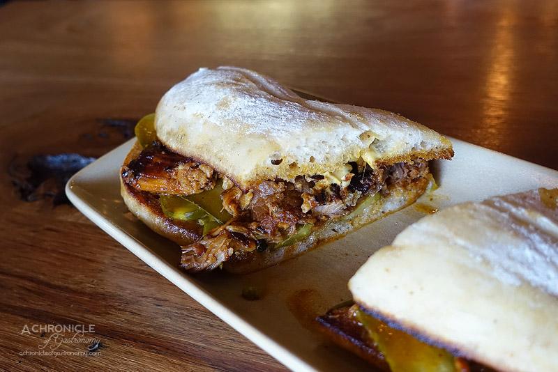 Hard Pressed - El Cubano - Orange braised pork, Swiss cheese, pickles, Dijon mustard ($15)