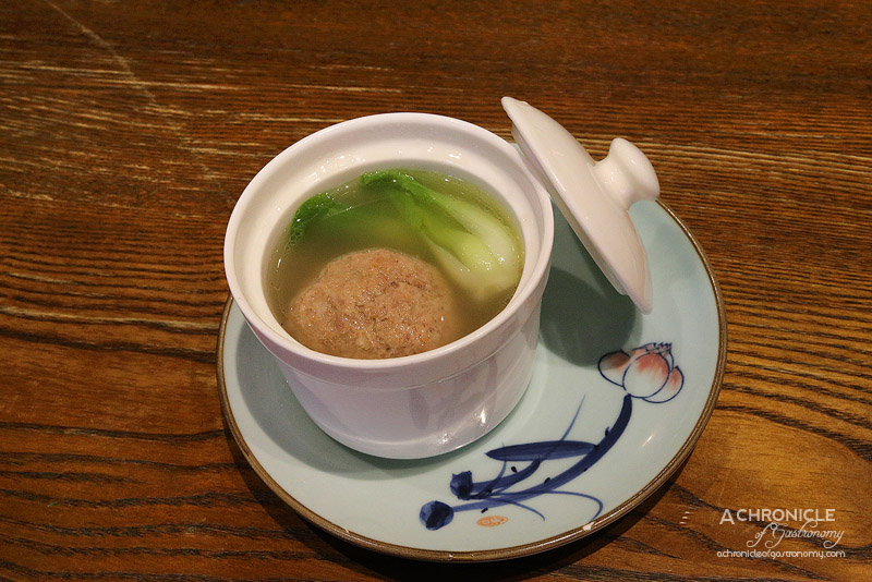 New Shanghai - Steamed 'Lion's Head' meatball in broth, crab meat and Chinese chestnut ($7.50)