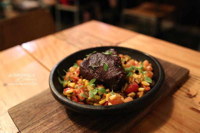 Markov - Braised beef cheek, roasted corn, tomato & caramelised onion ($25)