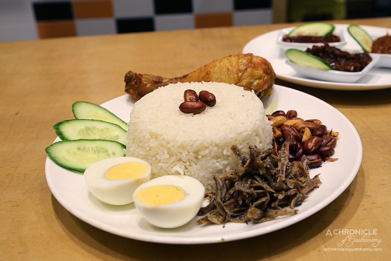 NL House - Fried Chicken Nasi Lemak - Coconut rice, boiled egg, cucumber, peanuts, ikan bilis ($10.90)