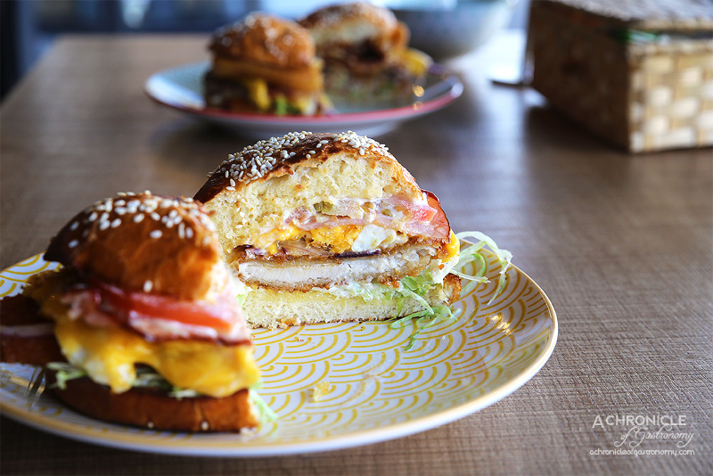 The Burger Block - Yellow Block Road - Schnitzel with American cheese, bacon, fried egg, spanish onions, lettuce, tomato and Jap mayo ($13.50)