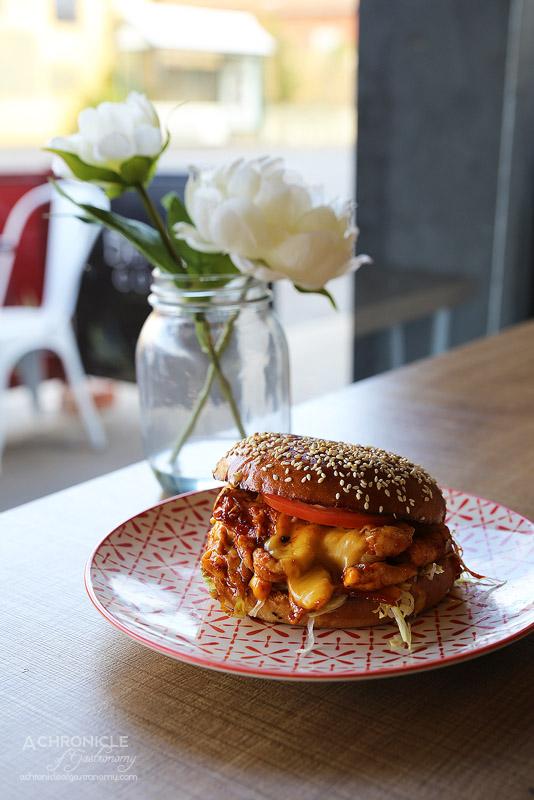 The Burger Block - The Hot Chick - Hot bulgogi sauce, American cheese, spanish onions, lettuce, tomato, chilli mayo ($13.50)